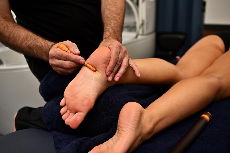 professional-massage-therapist-giving-reflexology-foot-massage