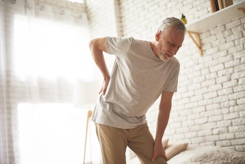 Senior Man Suffering Low Back Fatigue Backache.
