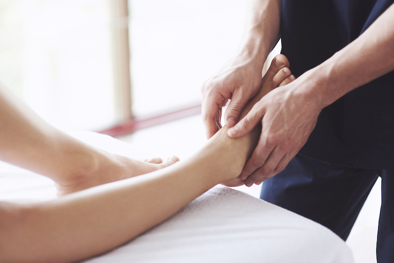 Woman's foot massage at the spa, relaxation rest.